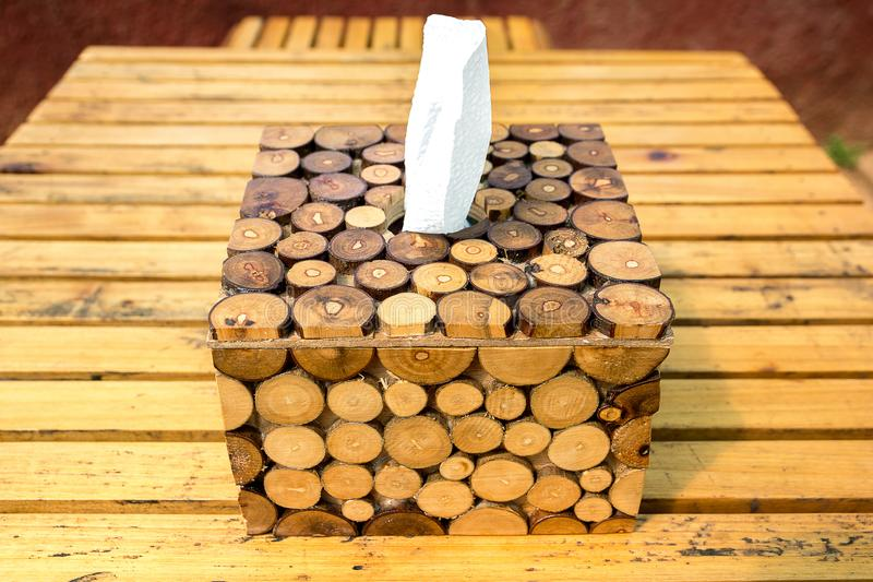 Wooden tissue box made from branches on the table royalty free stock image