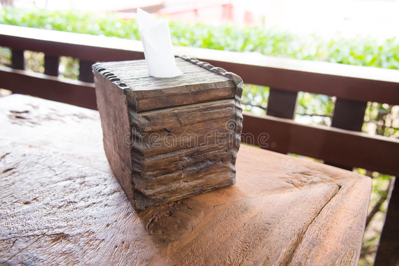 Wooden tissue box on table royalty free stock image