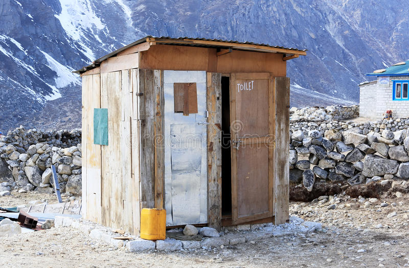 Wooden toilet in the mountains of the Himalayas. Everest region, Nepal.  stock photo