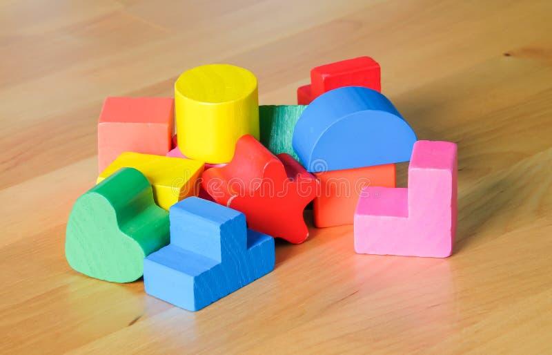 Wooden toy building blocks stock photos