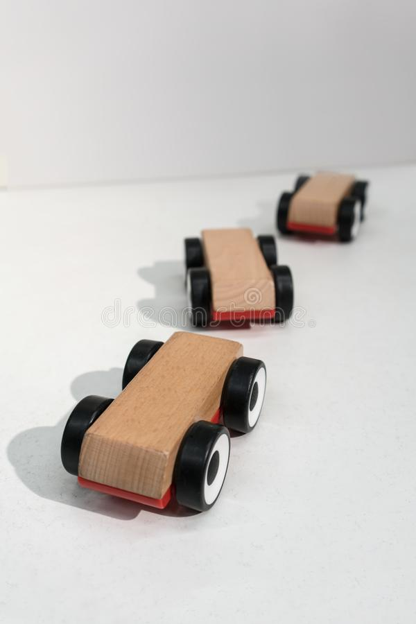 Wooden toy cars isolated on white background stock photo
