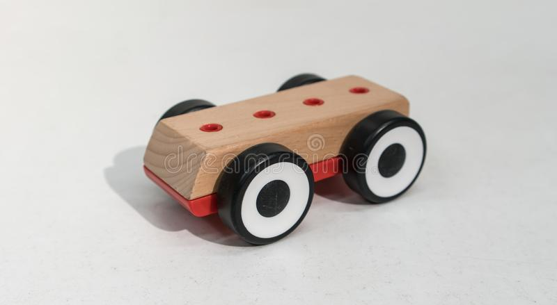 Wooden toy cars isolated on white background royalty free stock photography