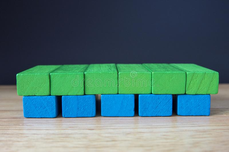 Wooden toy cubes on a brown wooden background royalty free stock photography