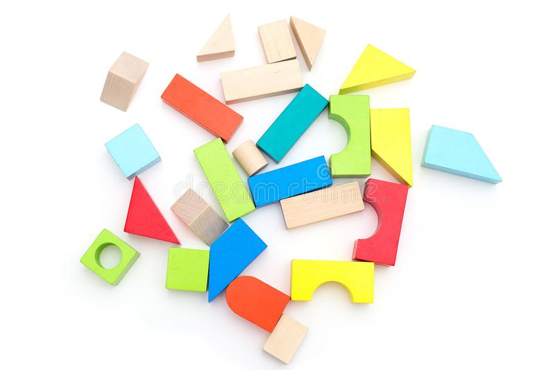 Wooden toy cubes on a white background. Isolated royalty free stock images