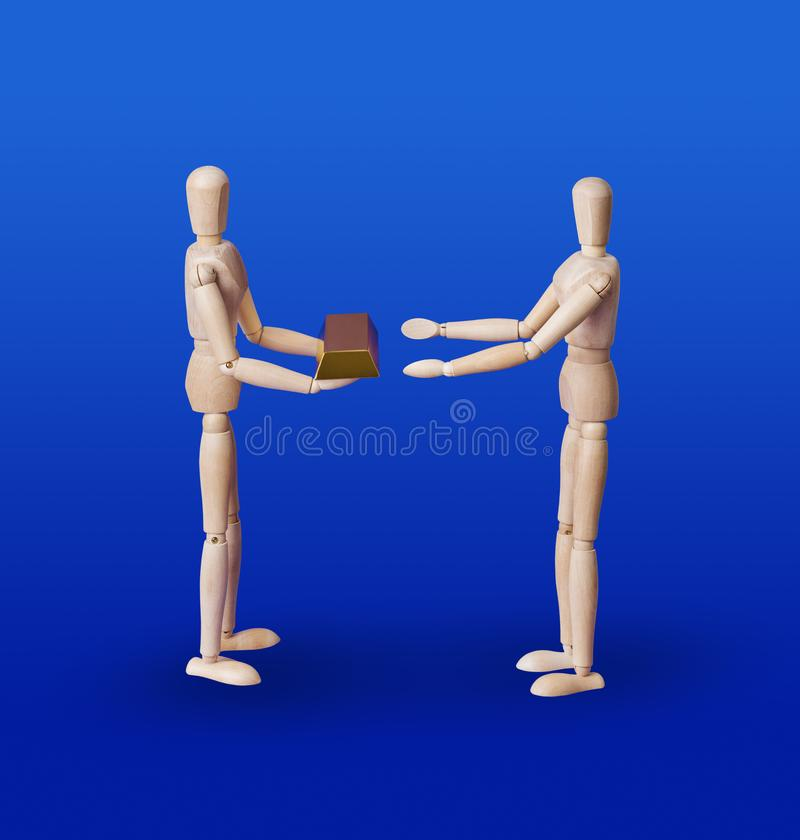 Wooden toy figures with gold on blue royalty free stock photo