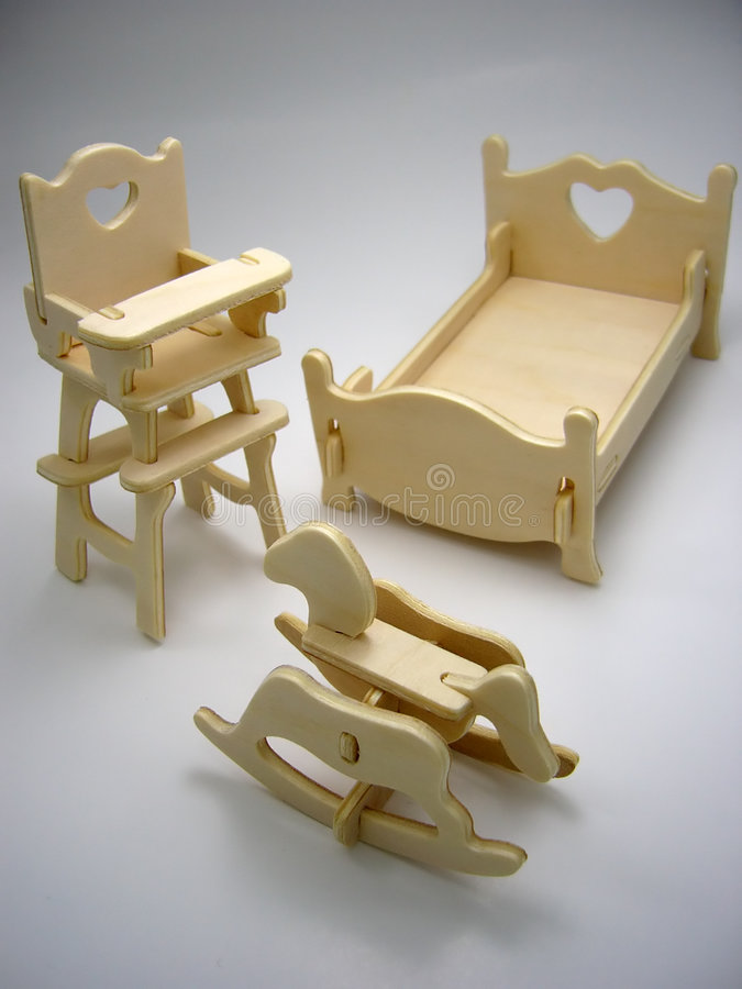 Wooden toy furniture of children`s bedroom stock images