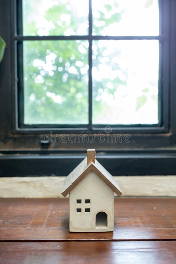 Wooden toy House on desk stock photo