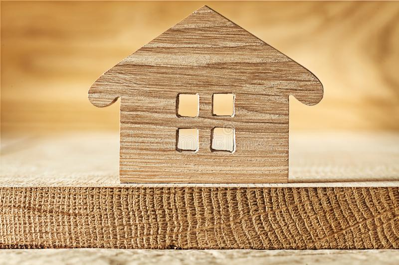Wooden toy house on wood background royalty free stock photography