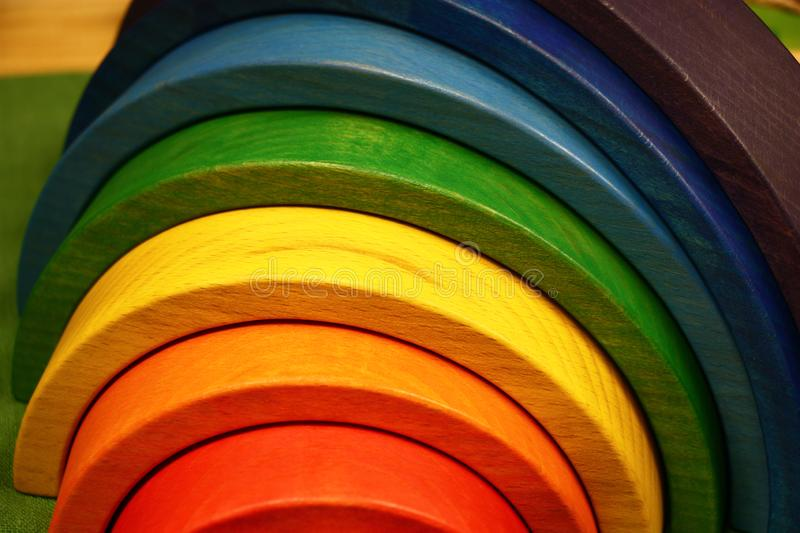Rainbow from wood. The wooden toy rainbow consists of eight original parts royalty free stock photo