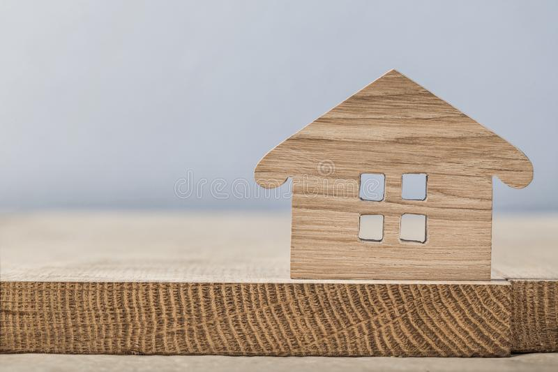 Wooden toy symbol house close up on wood board stock photo