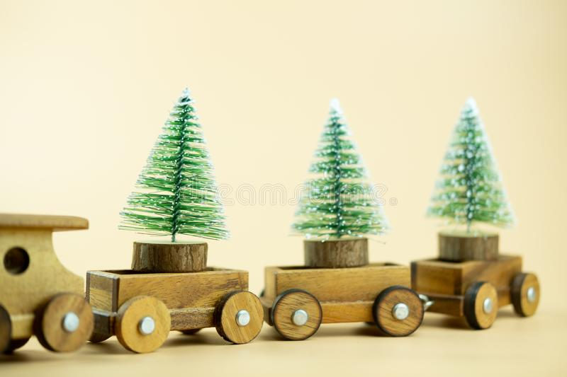 Wooden toy train carry on Christmas tree. Christmas holiday celebration concept stock images