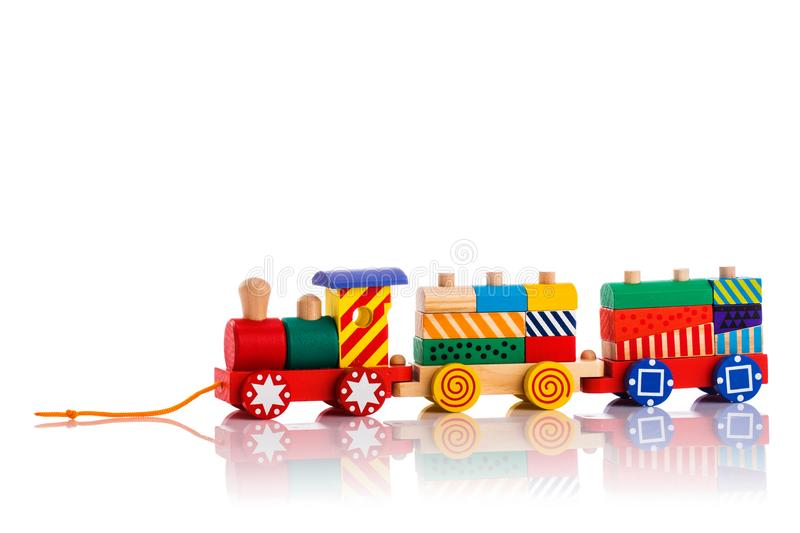 Wooden toy train with colorful blocks isolated over white background stock photo