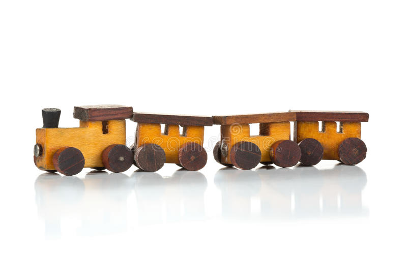 Wooden toy train with locomotive and wagons on white background stock image