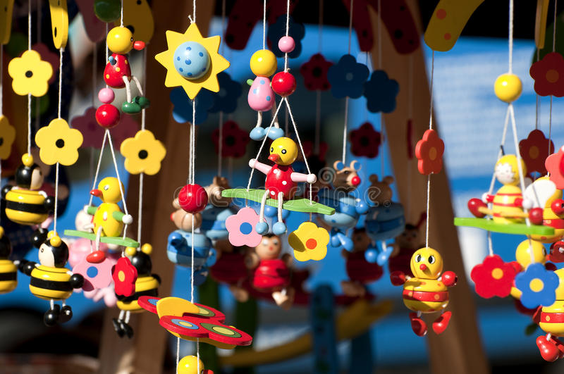 Wooden toys. Are swinging in the wind at a market royalty free stock images
