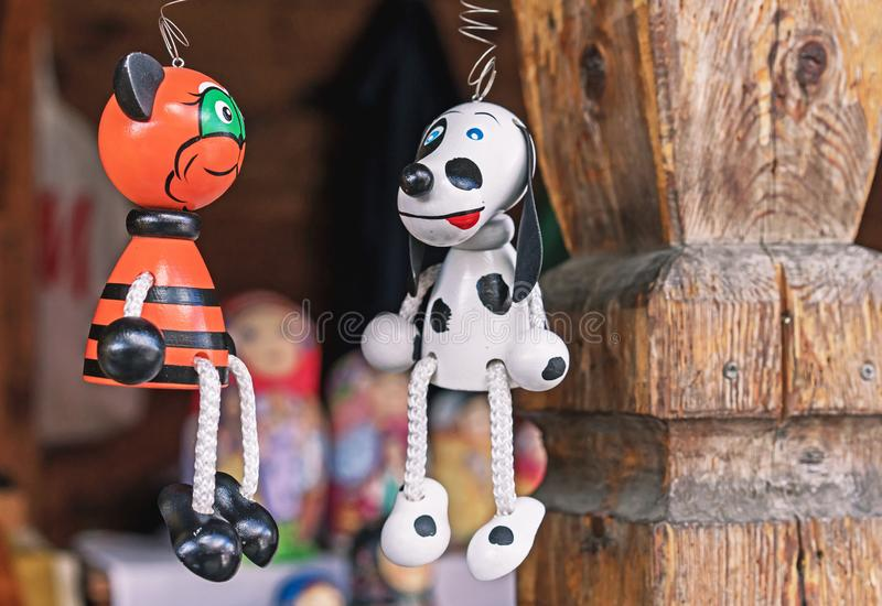 Wooden toys dog and cat on the street market royalty free stock photo
