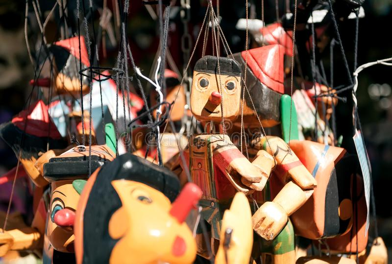 Wooden toys Pinocchio for sale in souvenir store of italian city. Historical Florence is UNESCO World Heritage Site royalty free stock images
