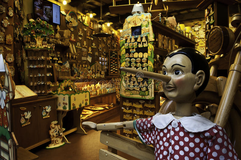 Wooden toys store with Pinocchio. Like a main character who welcome all guests . in Florence their are few stores with those wooden ecological toys for kids stock photo