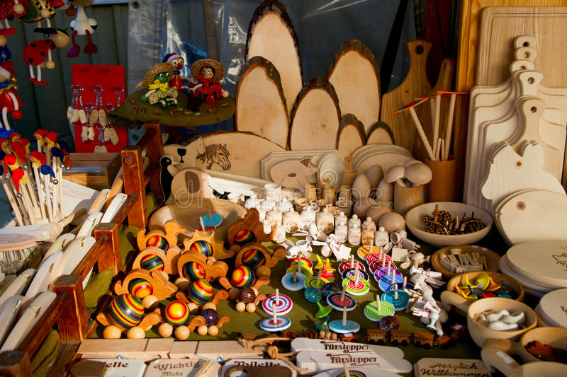 Wooden toys and utensils kitchen on a market stock photography