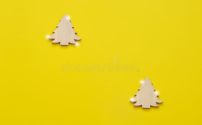 Wooden toys on yellow background. stock photo