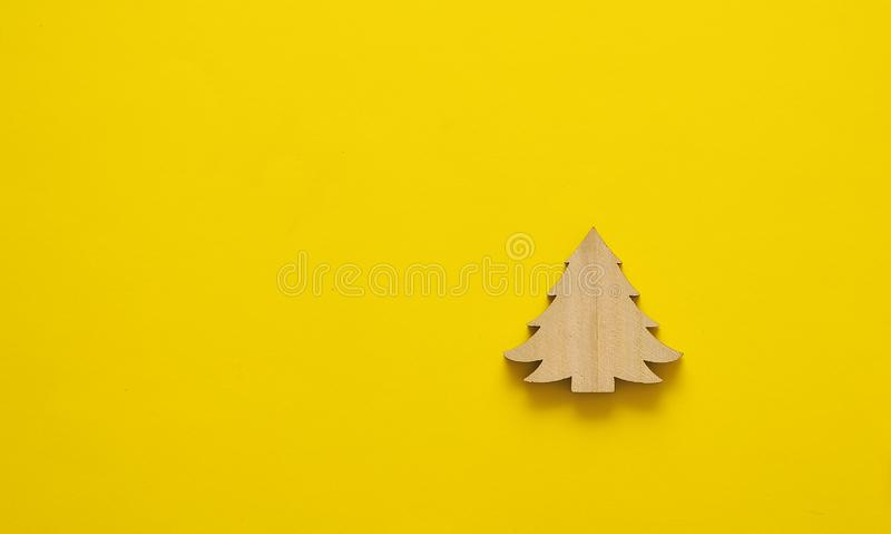 Wooden toys on yellow background. royalty free stock photo