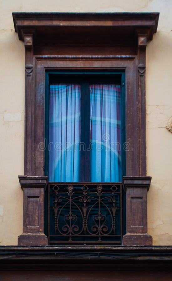 Wooden traditional window in Spain wit stucco decoration stock photo