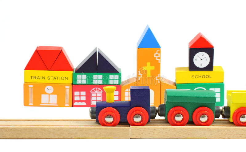 Wooden train and toyhouses over white royalty free stock images