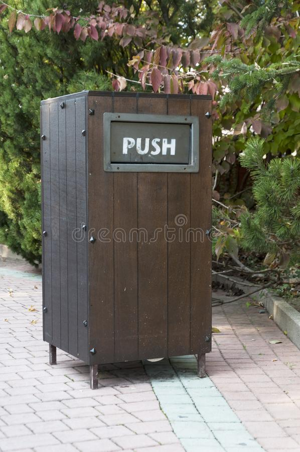 Wooden trash can with push stock photography