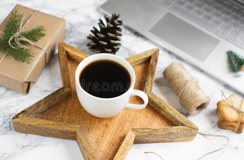 Wooden Tray Star Cup with Black Coffee Christmas Morning Gift Box Decoration Work Laptop New Year Concept. Scandinavian Style Design stock photos
