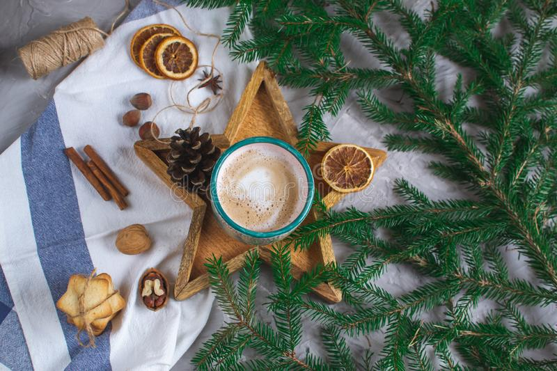 Wooden Tray Star Cup with Coffee Cappuccino Christmas Morning Cookies Decoration New Year Concept Winter Mood. Fir Tree Branch royalty free stock photo