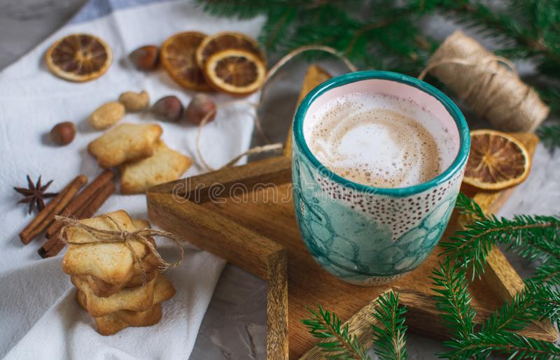 Wooden Tray Star Cup with Coffee Cappuccino Christmas Morning Cookies Decoration New Year Concept Winter Mood royalty free stock image