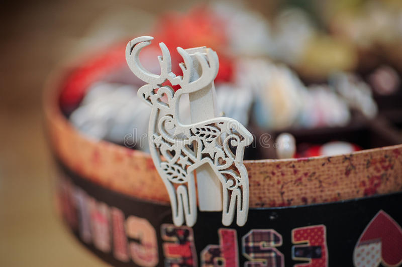 Wooden tree decorations in the shape of a deer royalty free stock photo