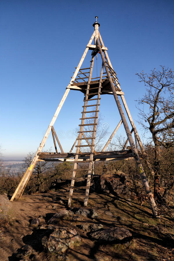 Wooden triangle outlook tower. Triangle outlook tower with wooden ladder stock photography