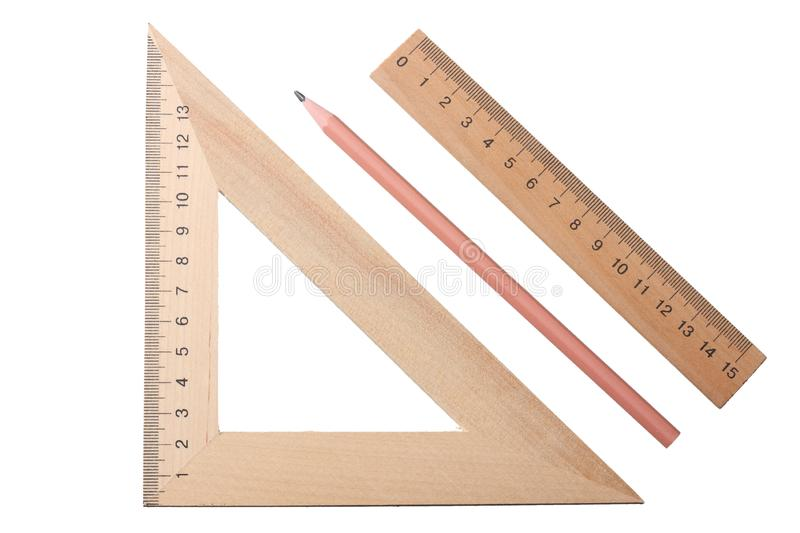 Wooden triangle with wooden ruler and pencil isolated on white background. top view stock photography