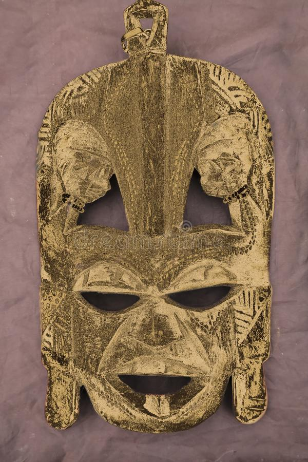 Wooden tribal mask. On table royalty free stock photography