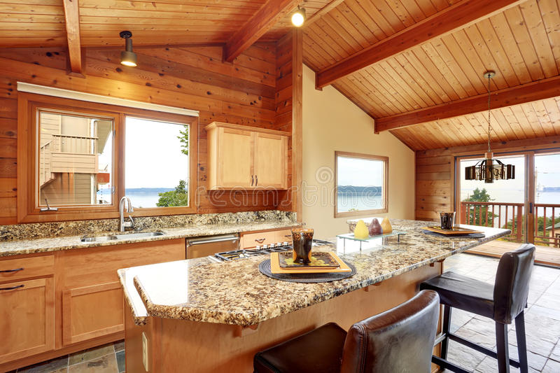 Wooden trim home with open floor plan. Kitchen with granite counter top. Wooden trim home with open floor plan. Kitchen with granite counter top and wooden royalty free stock image