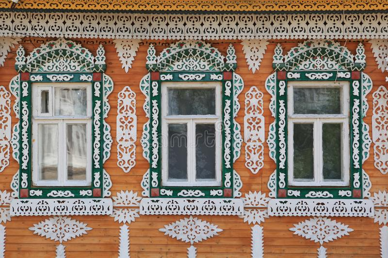 Wooden trim on the Windows of Russia. White royalty free stock photos