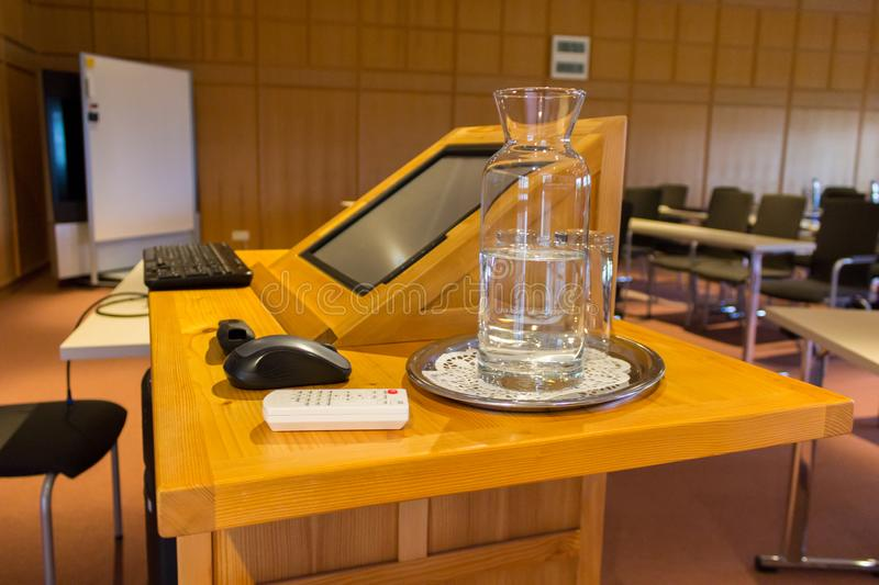 Wooden trubune in a conference or lecture hall royalty free stock photos