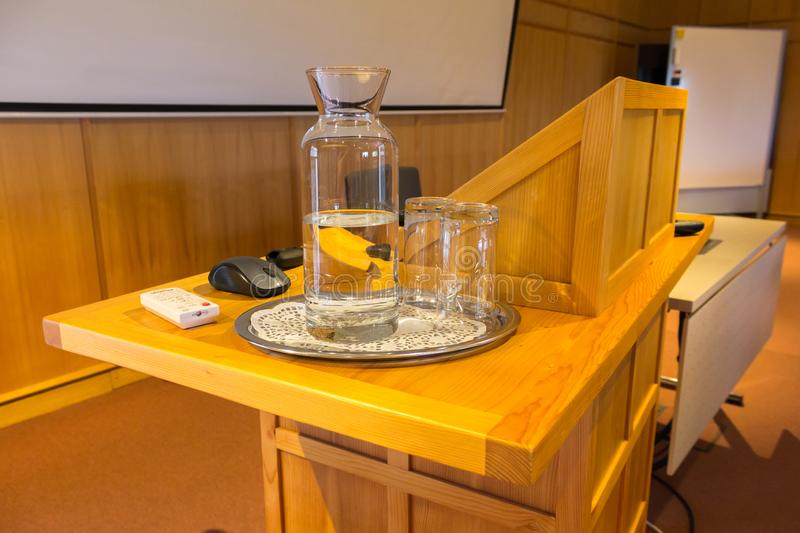 Wooden trubune in a conference or lecture hall stock image