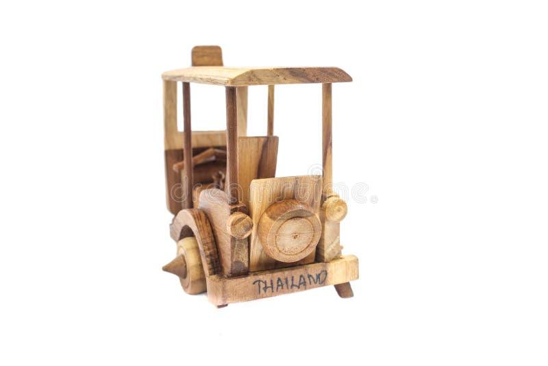 Wooden Tuk Tuk Taxi model. Three-Wheels on isolated photo stock photography