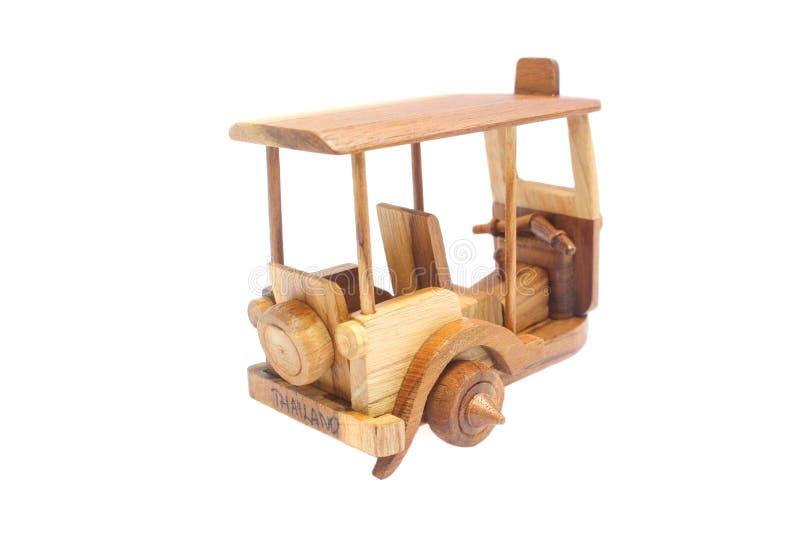 Wooden Tuk Tuk Taxi model. Three-Wheels on isolated photo stock image