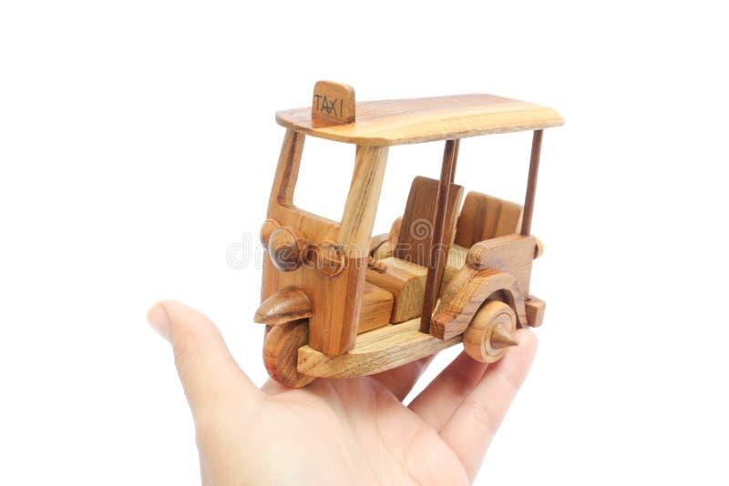 Wooden Tuk Tuk Taxi model. Three-Wheels on isolated photo stock images