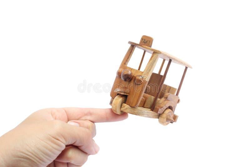 Wooden Tuk Tuk Taxi model. Three-Wheels on isolated photo royalty free stock photo