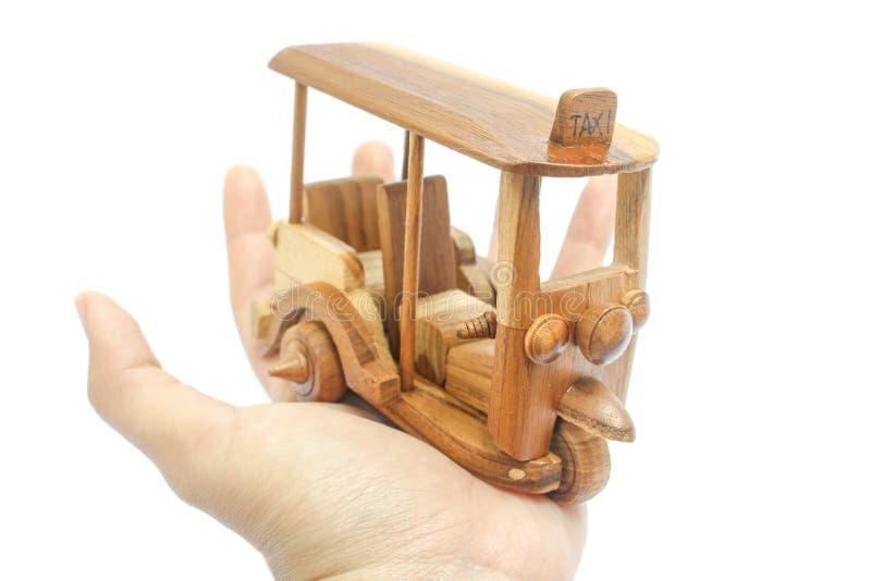 Wooden Tuk Tuk Taxi model. Three-Wheels on isolated photo stock photos
