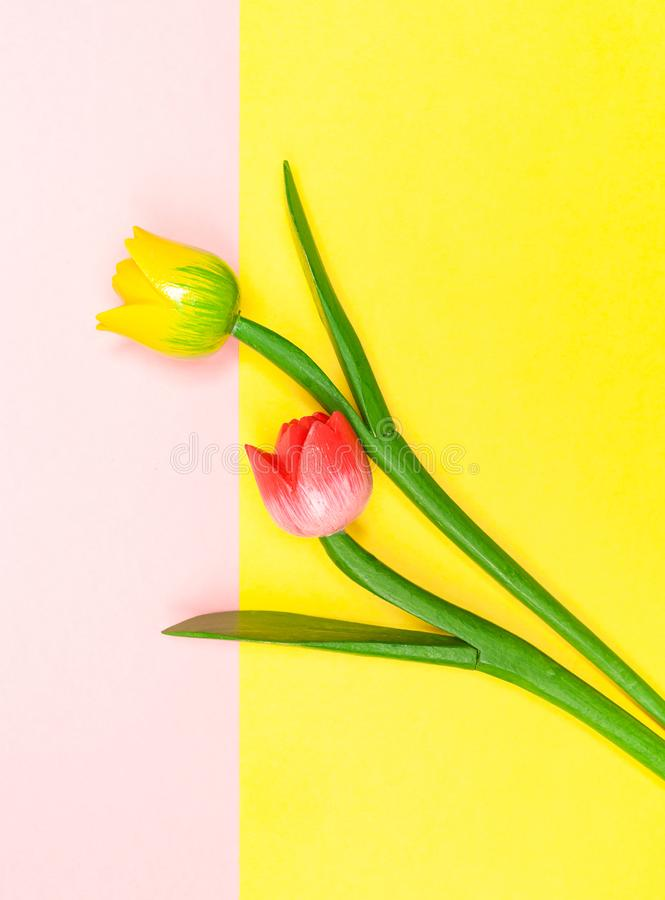 Wooden tulips contrasted with the background color. Flat lay Photography royalty free stock image