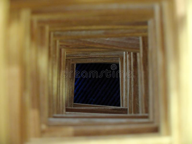 The wooden tunnel to the dark abyss. The concepts of loosing hope, hopeless future, misfortune and mistakes.The wooden tunnel to royalty free stock photo