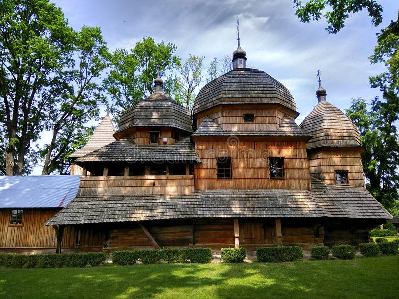 Wooden Ukrainian greek catholic church of Holy Mother of God in Chotyniec, Poland stock photo
