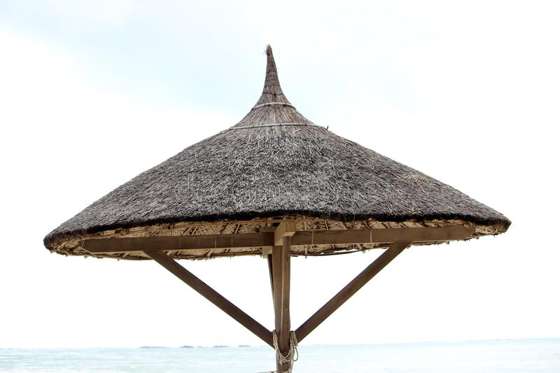 Wooden Umberlla at Beach. Wooden Umbrella for relaxation at beach stock photo