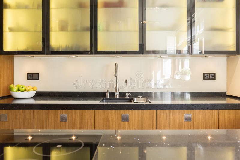 Wooden units in the kitchen royalty free stock photo