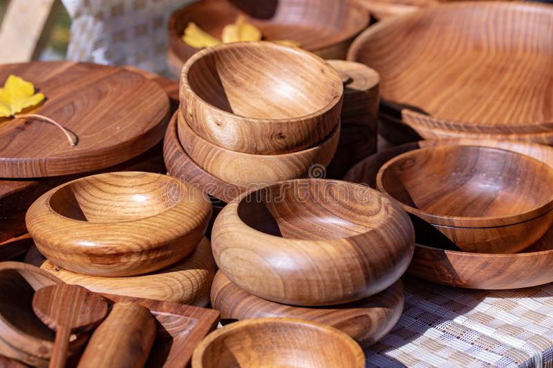 Wooden utensils. natural wood kitchen utensils - plates and supplies.  royalty free stock photo