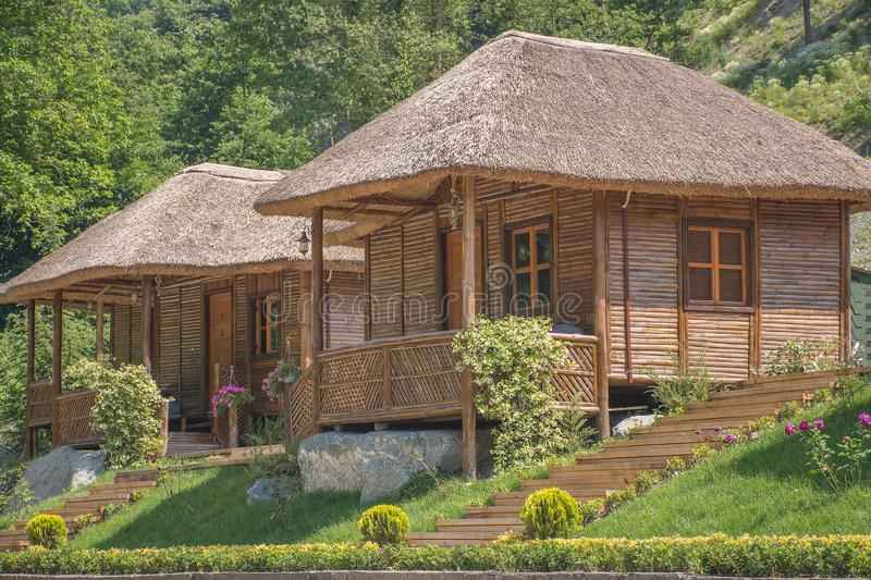 Wooden vacation bungalows in jungle stock photo